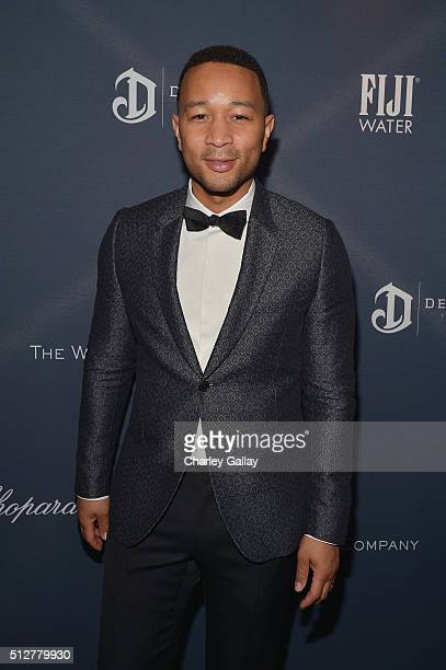 Recording artist John Legend attends The Weinstein Company's PreOscar Dinner presented in partnership with FIJI Water Chopard DeLeon and Lexus at the...