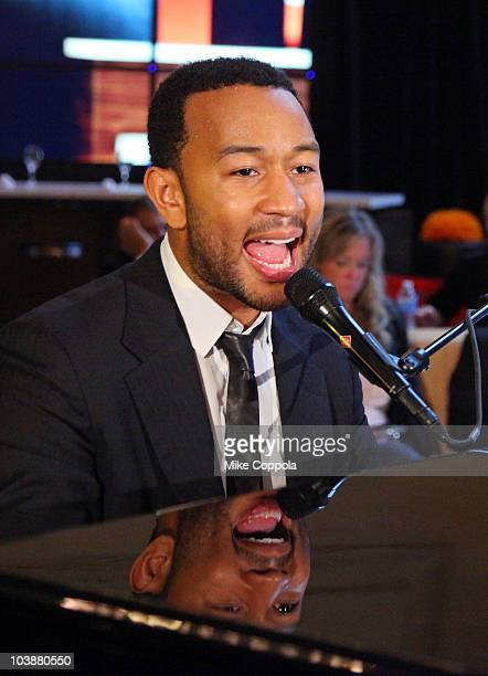 Recording artist John Legend performs at the Courtyard by Marriott Lobby Redesign Celebration at Vanderbilt Hall at Grand Central Terminal on...