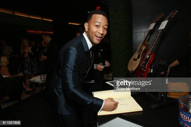 Recording artist John Legend with the GRAMMY Charities Signings during the 60th Annual GRAMMY Awards at Madison Square Garden on January 28 2018 in...