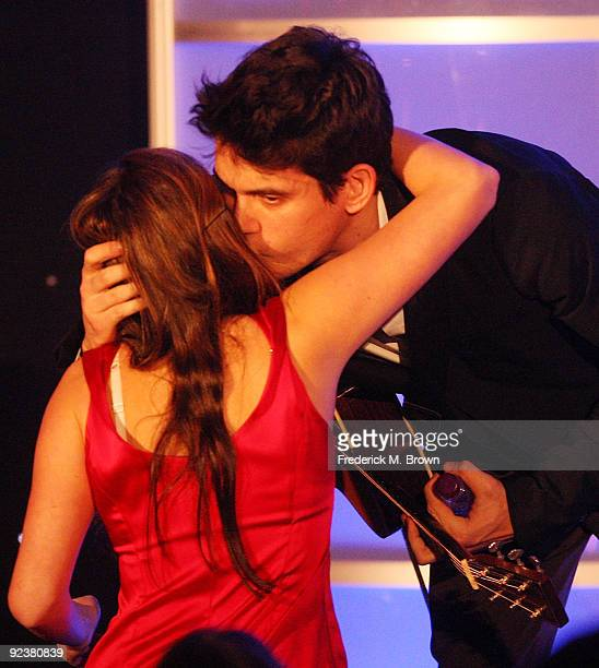 Recording artist John Mayer kisses a fan during the Fulfillment Fund's annual STARS 2009 benefit gala at the Beverly Hills Hotel on October 26 2009...