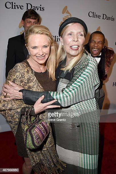 Recording artist Joni Mitchell and guest attend the PreGRAMMY Gala and Salute To Industry Icons honoring Martin Bandier on February 7 2015 in Los...