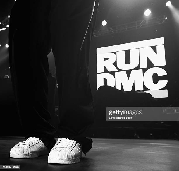 Recording artist Joseph Simmons shoe detail of Run–DMC performs onstage during DirecTV Super Saturday Night cohosted by Mark Cuban's AXS TV at Pier...