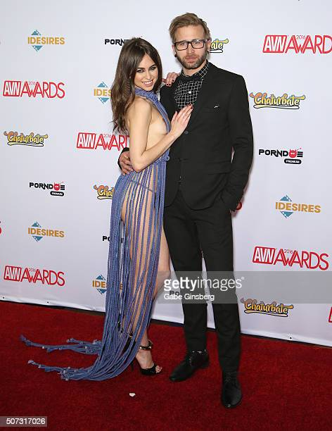 Recording artist Josh Ooah Mayer of The Glitch Mob and adult film actress Riley Reid attend the 2016 Adult Video News Awards at the Hard Rock Hotel...