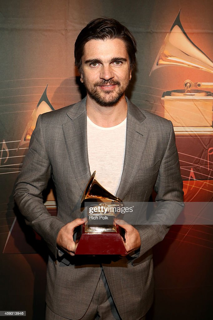 Recording artist Juanes poses with the Best Pop/Rock Album award for 'Loco de Amor' backstage at the 15th annual Latin GRAMMY Awards premiere ceremony at the Hollywood Theatre at the MGM Grand Hotel/Casino on November 20, 2014 in Las Vegas, Nevada.