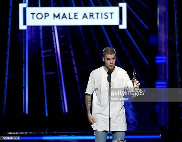 Recording artist Justin Bieber accepts the Top Male Artist award onstage during the 2016 Billboard Music Awards at TMobile Arena on May 22 2016 in...