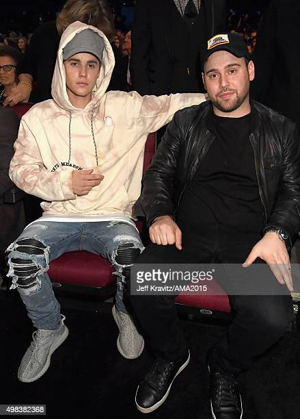Recording artist Justin Bieber and manager Scooter Braun attend the 2015 American Music Awards at Microsoft Theater on November 22 2015 in Los...