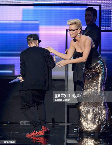 Recording artist Justin Bieber and TV Personality Jenny McCarthy onstage during the 40th Anniversary American Music Awards held at Nokia Theatre LA...