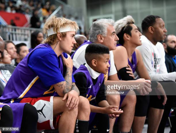 Recording artist Justin Bieber Demarjay Smith Marc Lasry and Kris Wu sit during the NBA AllStar Celebrity Game 2018 presented by Ruffles at Verizon...