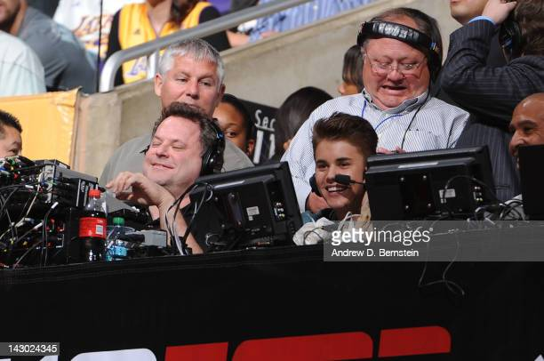 Recording artist Justin Bieber participates in a radio interview during a game between the San Antonio Spurs and the Los Angeles Lakers at Staples...