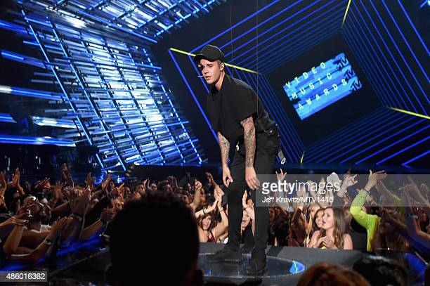Recording artist Justin Bieber performs onstage during the 2015 MTV Video Music Awards at Microsoft Theater on August 30 2015 in Los Angeles...