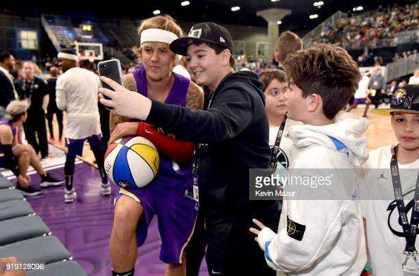 Recording artist Justin Bieber takes a selfie with fans during the NBA AllStar Celebrity Game 2018 presented by Ruffles at Verizon Up Arena at LACC...