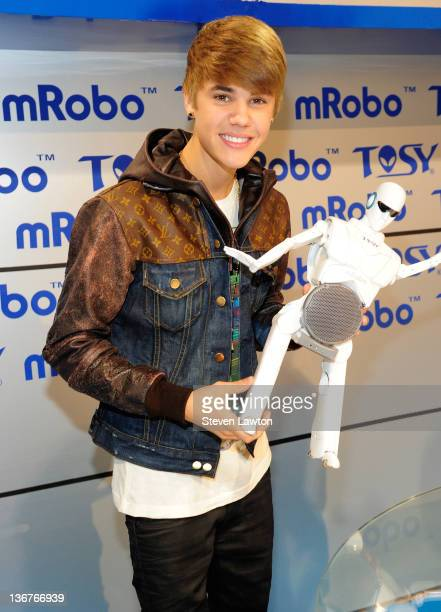 Recording artist Justin Bieber unveils the TOSY mRobo Robot CES 2012 at Las Vegas Convention Center on January 11, 2012 in Las Vegas, Nevada.