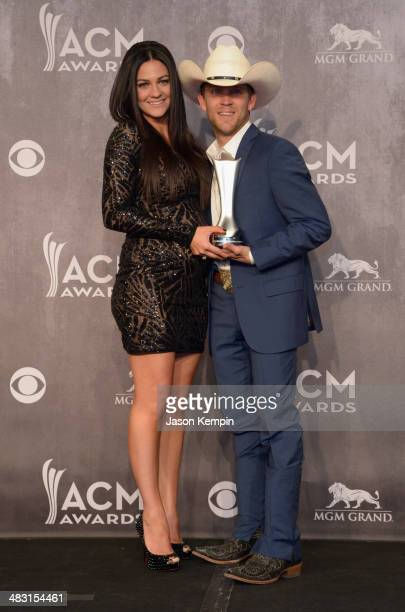 Recording artist Justin Moore and Kate Moore pose in the press room at the 49th Annual Academy Of Country Music Awards at the MGM Grand Garden Arena...