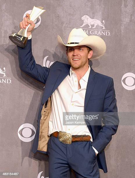 Recording artist Justin Moore poses in the press room at the 49th Annual Academy Of Country Music Awards at the MGM Grand Garden Arena on April 6...