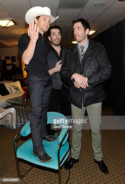 Recording artist Justin Moore television personalities Jonathan Scott and Drew Scott attend the Backstage Creations Celebrity Retreat at the American...