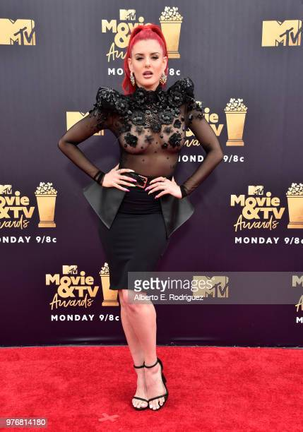 Recording artist Justina Valentine attends the 2018 MTV Movie And TV Awards at Barker Hangar on June 16 2018 in Santa Monica California