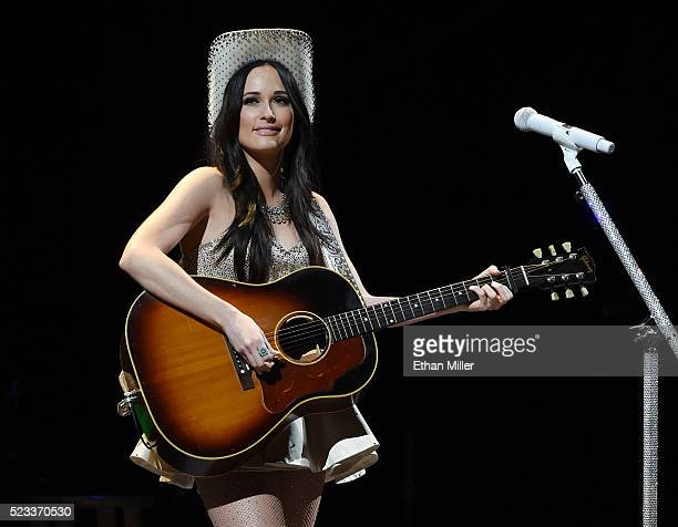 Recording artist Kacey Musgraves performs as she opens for George Strait during the first of his Strait to Vegas shows at TMobile Arena on April 22...