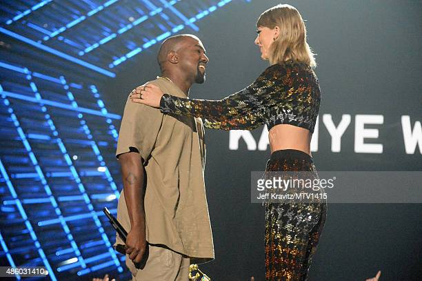 Recording artist Kanye West accepts the Michael Jackson Video Vanguard Award from Taylor Swift onstage during the 2015 MTV Video Music Awards at...
