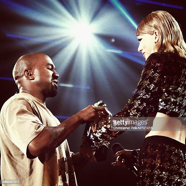 Recording artist Kanye West accepts the Vanguard Award from recording artist Taylor Swift onstage during the 2015 MTV Video Music Awards at Microsoft...