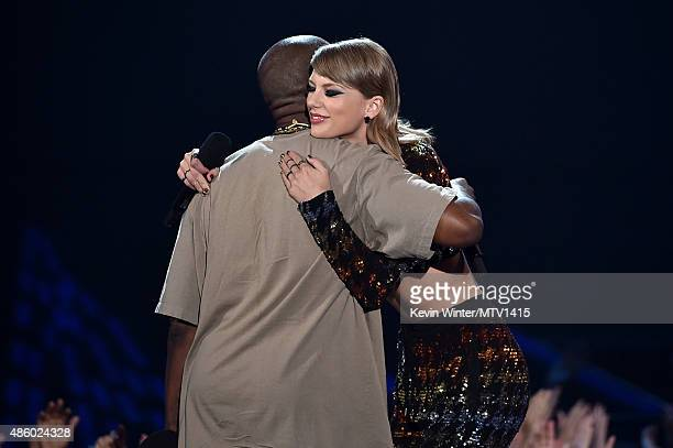 Recording artist Kanye West accepts the Video Vanguard Award from recording artist Taylor Swift onstage during the 2015 MTV Video Music Awards at...
