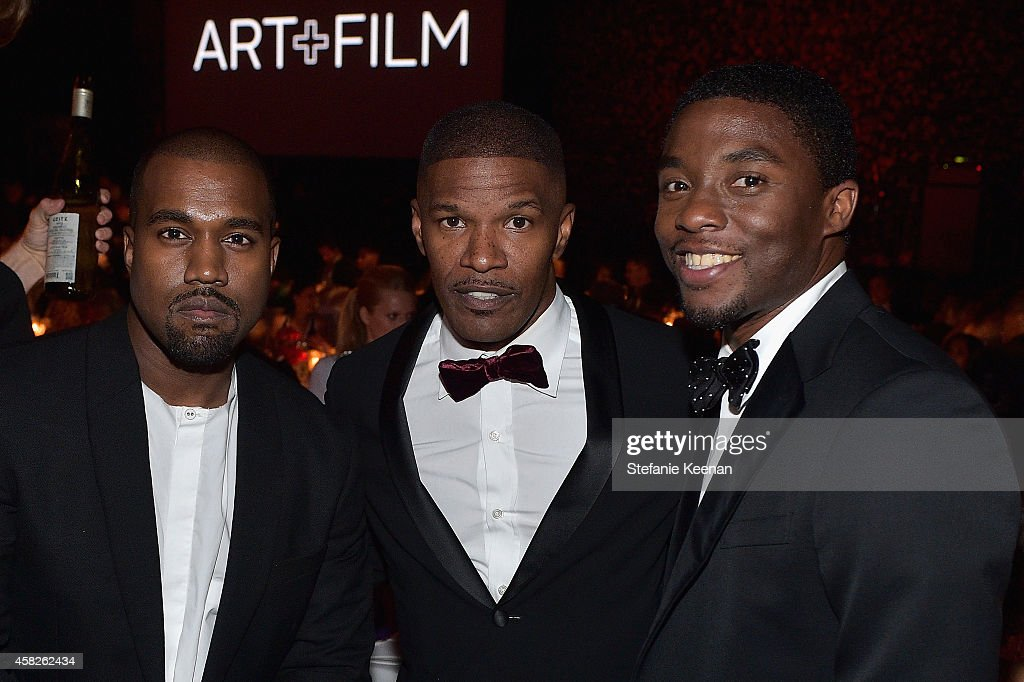 Recording artist Kanye West and actors Jamie Foxx and Chadwick Boseman, wearing Gucci, attend the 2014 LACMA Art + Film Gala honoring Barbara Kruger and Quentin Tarantino presented by Gucci at LACMA on November 1, 2014 in Los Angeles, California.