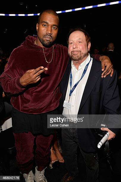 Recording artist Kanye West and Grammys executive producer Ken Ehrlich onstage during The 57th Annual GRAMMY Awards at the STAPLES Center on February...