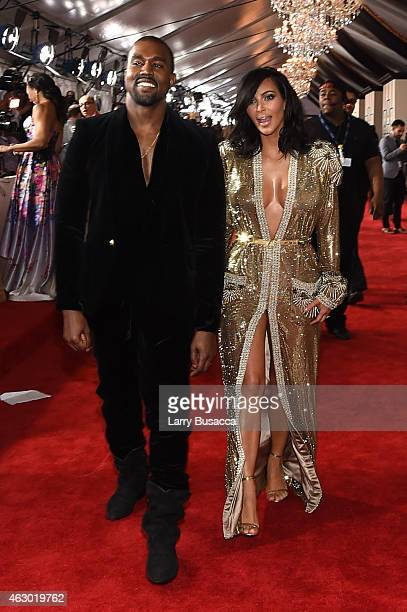 Recording Artist Kanye West and Kim Kardashian attend The 57th Annual GRAMMY Awards at the STAPLES Center on February 8 2015 in Los Angeles California