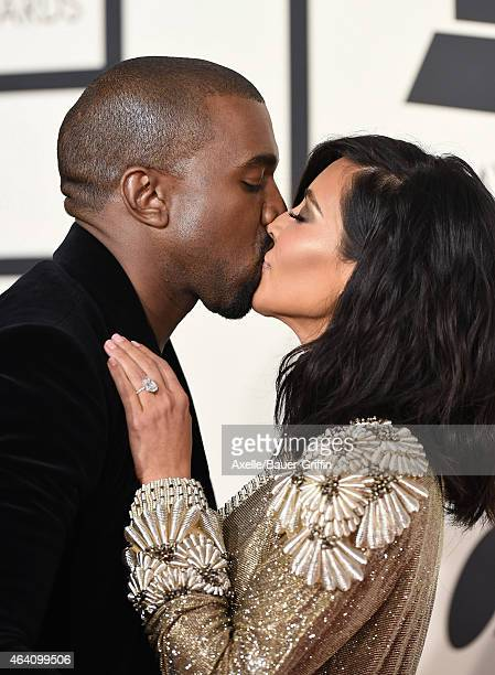 Recording artist Kanye West and TV personality Kim Kardashian arrive at the 57th Annual GRAMMY Awards at Staples Center on February 8 2015 in Los...