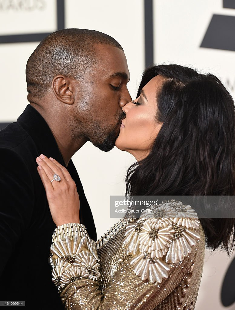 Recording artist Kanye West (L) and TV personality Kim Kardashian arrive at the 57th Annual GRAMMY Awards at Staples Center on February 8, 2015 in Los Angeles, California.