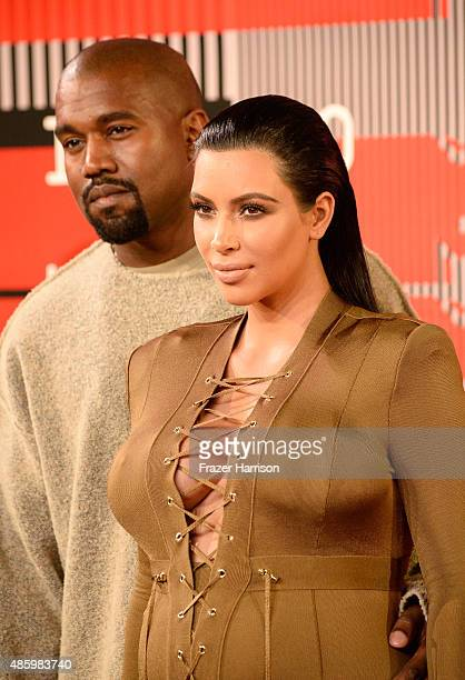 Recording artist Kanye West and tv personality Kim Kardashian attend the 2015 MTV Video Music Awards at Microsoft Theater on August 30 2015 in Los...
