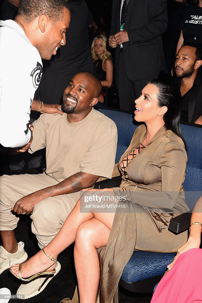 Recording artist Kanye West (C) and TV personality Kim Kardashian attend the 2015 MTV Video Music Awards at Microsoft Theater on August 30, 2015 in Los Angeles, California.
