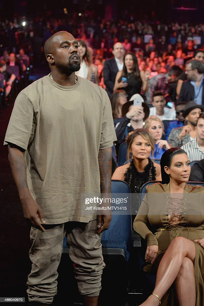 Recording artist Kanye West (L) and TV personality Kim Kardashian attend the 2015 MTV Video Music Awards at Microsoft Theater on August 30, 2015 in Los Angeles, California.