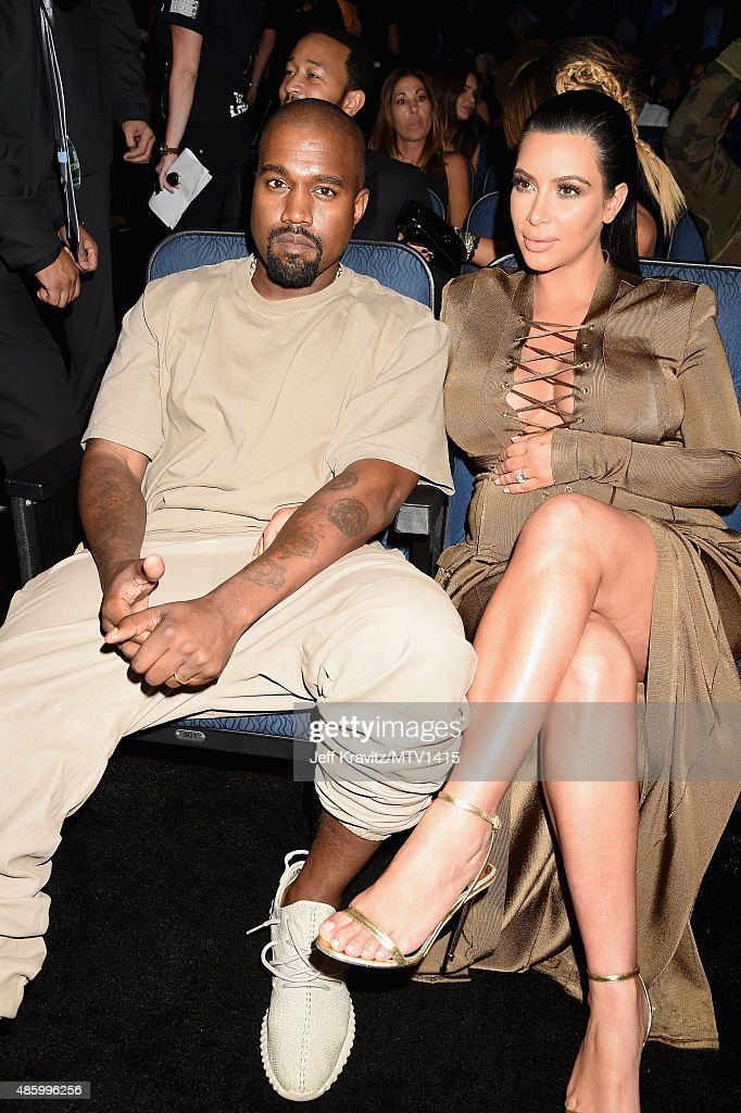 Recording artist Kanye West (L) and TV Personality Kim Kardashian during the 2015 MTV Video Music Awards at Microsoft Theater on August 30, 2015 in Los Angeles, California.