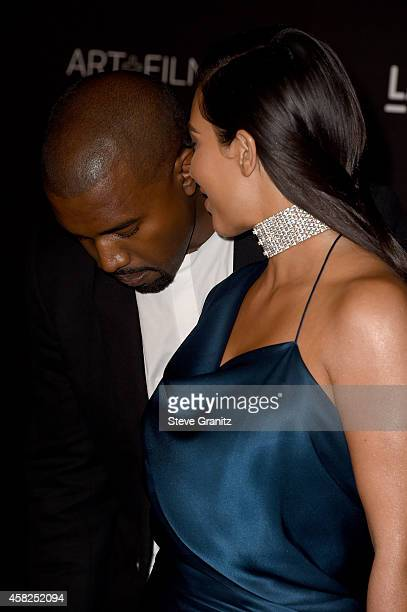 Recording artist Kanye West and TV personality Kim Kardashian West attend the 2014 LACMA Art Film Gala honoring Barbara Kruger and Quentin Tarantino...