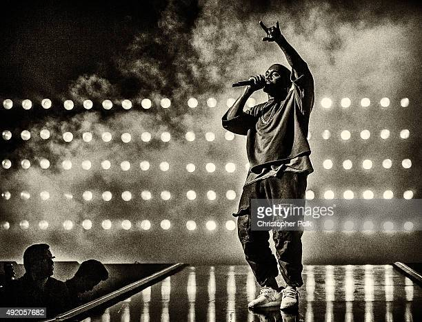 Image has been converted to black and white Recording artist Kanye West performs onstage at the 2015 iHeartRadio Music Festival at MGM Grand Garden...