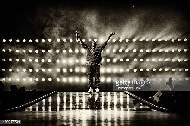 Image has been converted to black and white.) Recording artist Kanye West performs onstage at the 2015 iHeartRadio Music Festival at MGM Grand Garden...