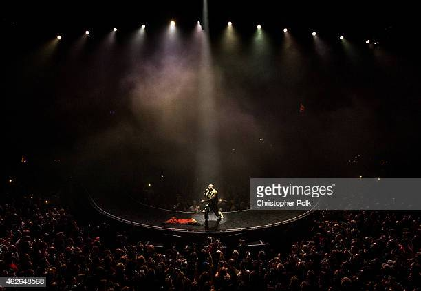 Recording artist Kanye West performs onstage during DirecTV Super Saturday Night hosted by Mark Cuban's AXS TV and Pro Football Hall of Famer Michael...