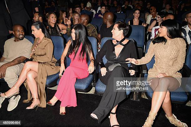 Recording artist Kanye West with TV personalities Kim Kardashian Kourtney Kardashian Kris Jenner and Kylie Jenner during the 2015 MTV Video Music...