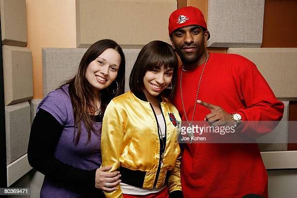 NEW YORK MARCH 24 Recording Artist Karina Pasian poses for a photo with Nadine Santos Power 1051 Music Director and DJ Clue at Power 1051 Studio on...