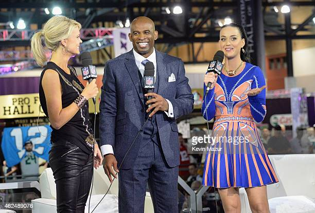 Recording artist Katy Perry is interviewed by sportscaster Melissa Stark and former NFL player and sports analyst Deion Sanders at the NFL Experience...