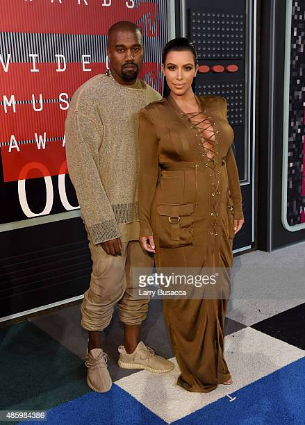 Recording artist Kayne West and TV personality Kim Kardashian attend the 2015 MTV Video Music Awards at Microsoft Theater on August 30 2015 in Los...