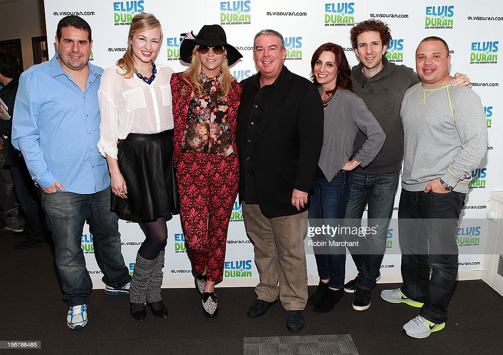 Recording artist Ke$ha (C) poses with members of the Elvis Duran Z100 Morning Show (L-R) Skeery Jones, Bethany Watson, Elvis Duran, Danielle Monaro, TJ and Greg T at Z100 Studio on November 20, 2012 in New York City.