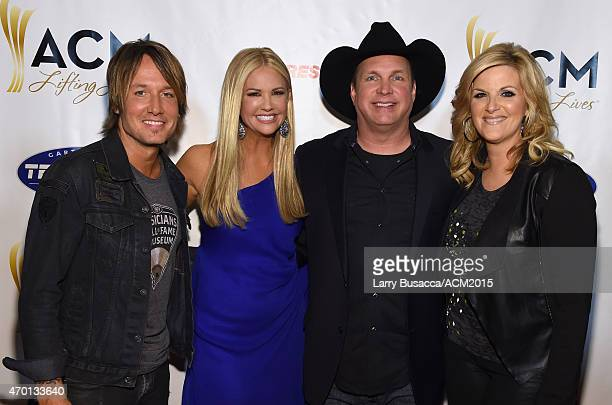 Recording artist Keith Urban cohost Nancy O'Dell host Garth Brooks and host Trisha Yearwood attend the ACM Lifting Lives Gala at the Omni Hotel on...