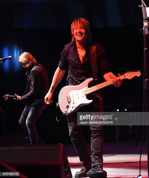 Recording artist Keith Urban performs onstage during the ACM Lifting Lives Gala at the Omni Hotel on April 17, 2015 in Dallas, Texas.