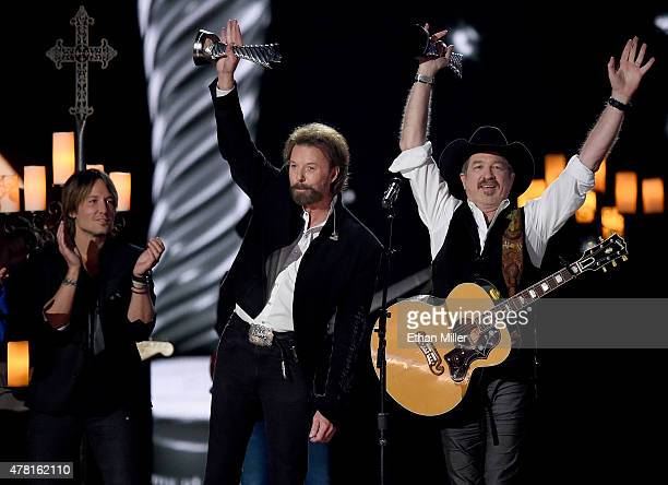 Recording artist Keith Urban presents honorees Ronnie Dunn and Kix Brooks of Brooks Dunn with the 50th Anniversary Milestone Award for Most Awarded...