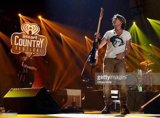 Recording artist Keith Urban takes off his guitar as he performs during the 2016 iHeartCountry Festival at The Frank Erwin Center on April 30 2016 in...