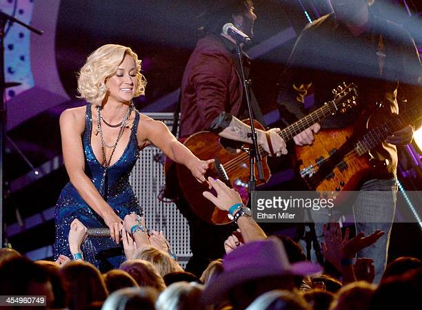 Recording artist Kellie Pickler performs onstage during the American Country Awards 2013 at the Mandalay Bay Events Center on December 10, 2013 in...