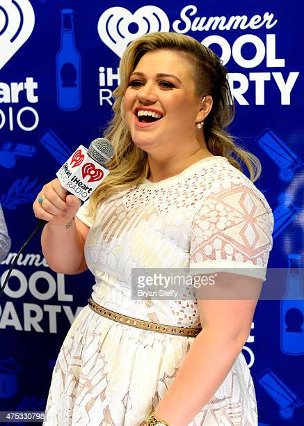 Recording artist Kelly Clarkson attends The iHeartRadio Summer Pool Party at Caesars Palace on May 30 2015 in Las Vegas Nevada