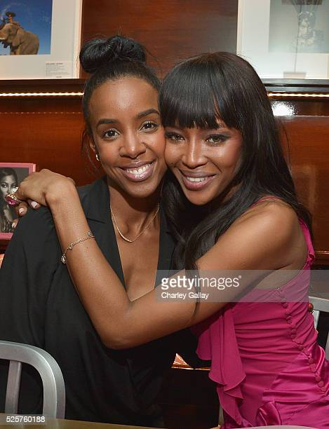 Recording artist Kelly Rowland and model Naomi Campbell attend the Los Angeles launch of Naomi at Taschen Beverly Hills on April 28 2016 in Beverly...