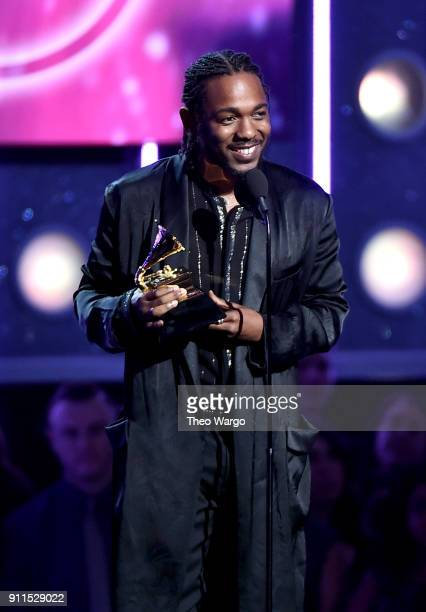 Recording artist Kendrick Lamar accepts the Best Rap Album award for 'Damn' onstage during the 60th Annual GRAMMY Awards at Madison Square Garden on...